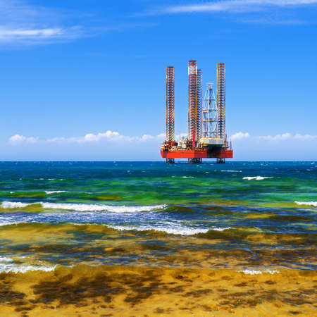 boring frame: Offshore oil and Gas Production. Drilling platform in the sea against a blue sky