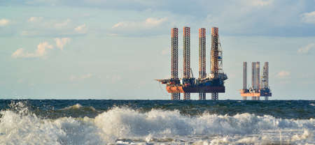 boring frame: Drilling platforms in the sea at the morning against a blue sky.  Sea station of gas production Stock Photo