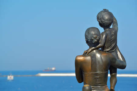 Beautiful view of the open sea with a sculpture to the sailors wife in the seaport of Odessa. Black Sea. Ukraine