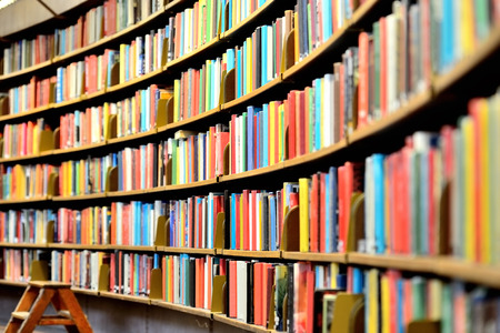 Round bookshelf in public library Фото со стока