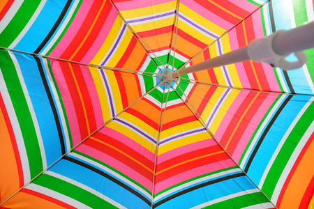 Parasol on beach seen from under