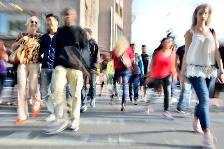 zoom in: Zoom and motion blurred crowd crossing street. Blur effects made in lens, not post processing.