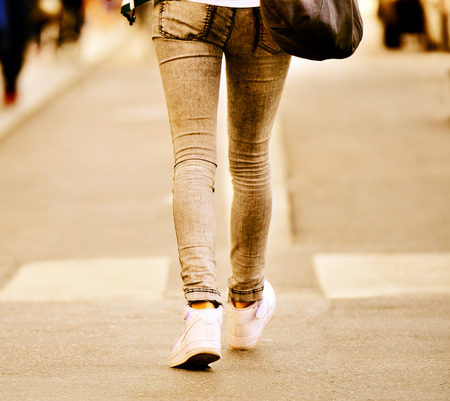 Close up of person walking on street Standard-Bild