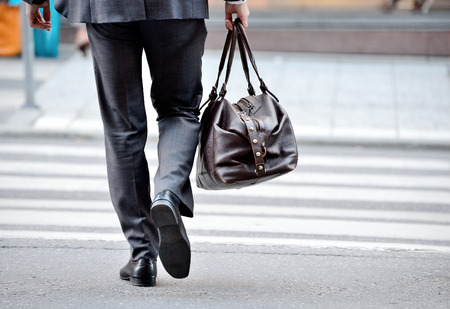 Man in suit with bag, on zebra crossing Stock Photo