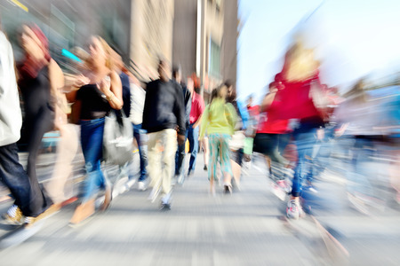 Zoom and motion blurred crowd crossing street. Blur effects made in lens, not post processing.