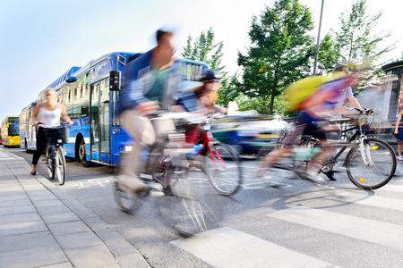 Motion blurred bicyclists in traffic Standard-Bild