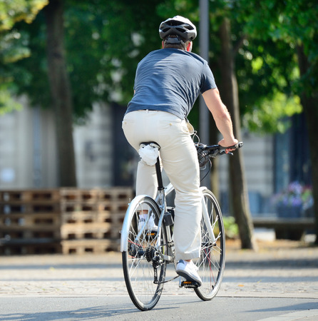 Rear view of bicyclist with helmet