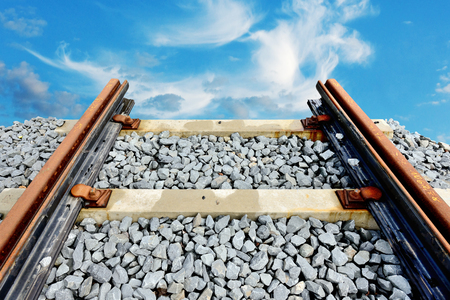 end of the line: Railroad ending into cloudy sky