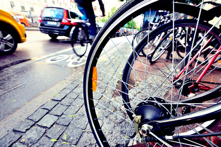 Close up of bicycle, bike and bike lane in background Stock Photo