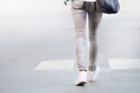 Abstract, woman in jeans walking 写真素材