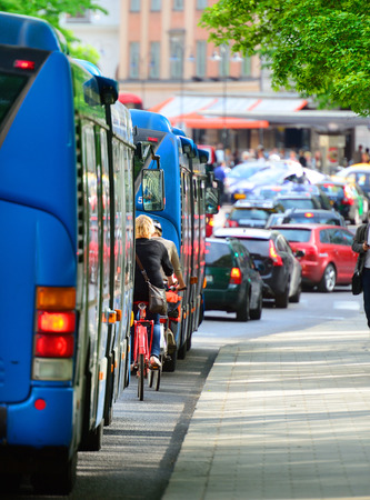 Buses and bikes in traffic photo