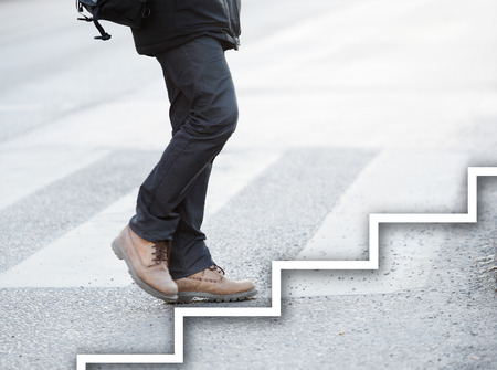 Man taking the next step 스톡 콘텐츠