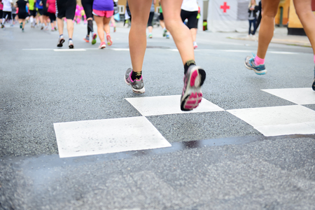 young feet: Runners crossing start or finish line