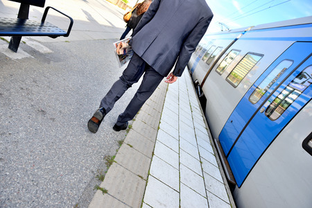 Man and commuter train Stock Photo