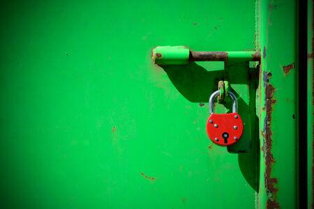 Red padlock and very green door photo