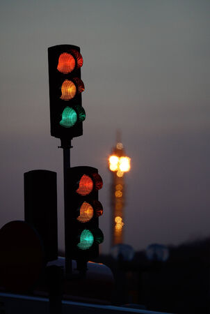 Traffic light against sunset and tv-tower Stock Photo