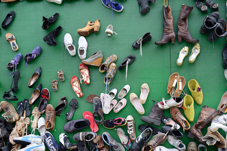 Shoes, lots of used in pile