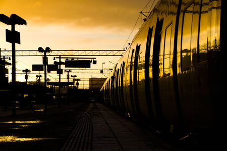 commuter train: Sunset over commuter train