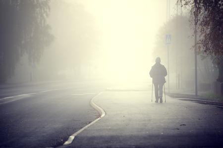Woman walking in the fog