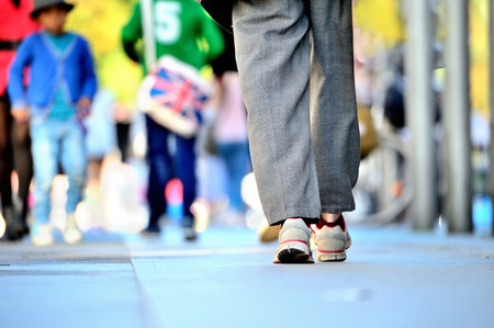 Close up of person walking on street 写真素材