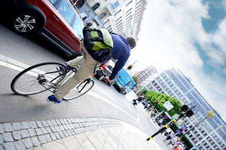 Man on bike in city traffic Standard-Bild