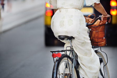 Woman on bike, evening traffic