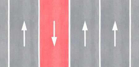 one lane street sign: One is against. Arrow reversed against the others. Stock Photo