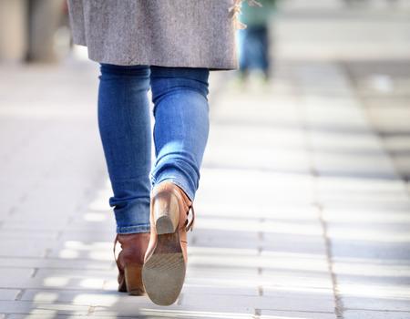 Woman walking into bright light (future?) Standard-Bild
