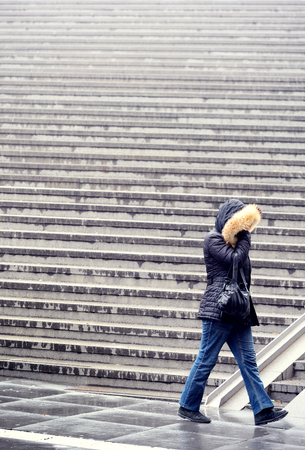 Woman and stairs, it's raining