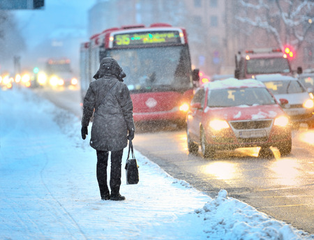 sweden winter: Commuters waiting for arriving bus in snowstorm