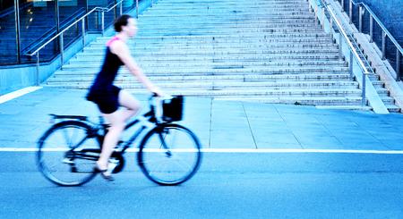 Woman in profile on bike