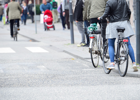 Person getting on bike Standard-Bild
