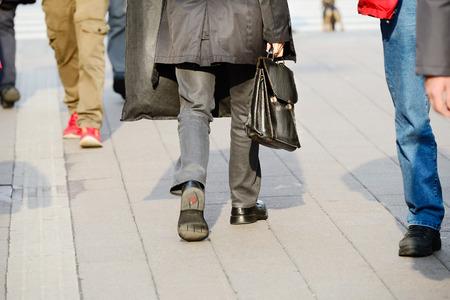 Suit man in silhouette walking on the street.