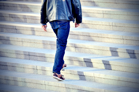 down the stairs: Hombre caminando por las escaleras Foto de archivo