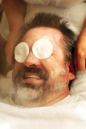 treatment: Senior man getting full facial at spa