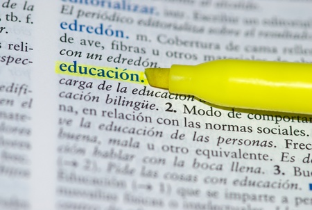 Spanish dictionary definition of the word education with focus on education and a hallow field depth