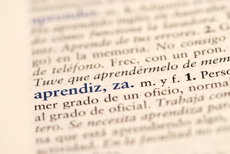 Closeup of spanish dictionary word for apprentice