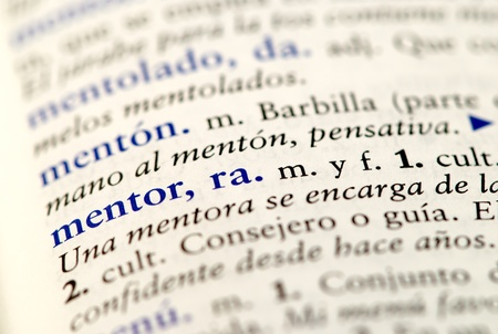 closup of Spanish dictionary word for mentor photo
