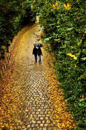 couple WALKING: Couple walking in the rain