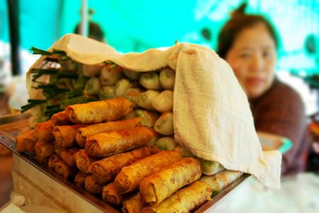 haggling: Market stall with fresh and fried springrolls wrapped in rice paper