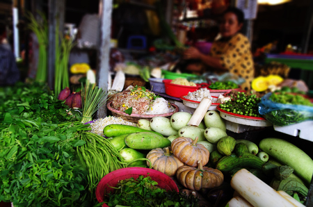 haggling: Vegetable seller at a local market scene in Phnom Penh, Cambodia