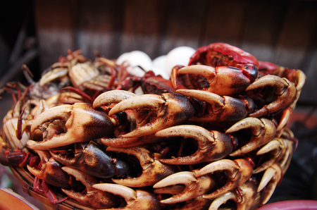 dozens: Dozens of crab claws piled up for sale Stock Photo