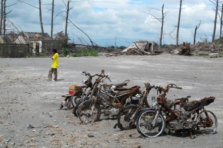 devastation: Burnt motorbike after volcanic eruption in Indonesia, leaving debris and ash from caldera, natural disaster