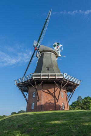 The Green Mill of the Greetsiel Twin Mills, Eastern Frisia, Germany Standard-Bild