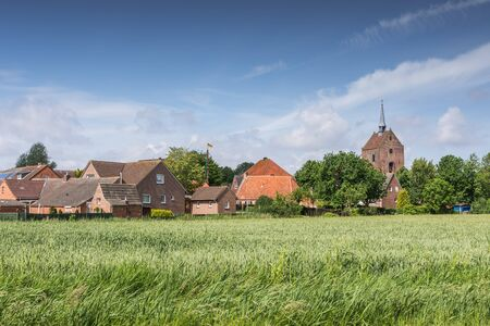A typical village in Eastern Frisia, Germany Standard-Bild