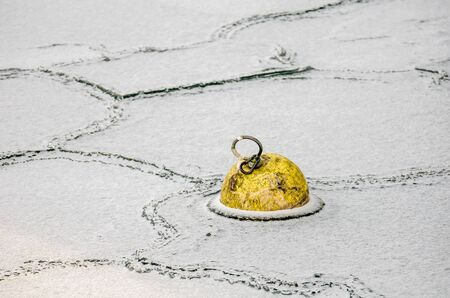 Frozen Yellow Buoy and Abstract Ice Texture at Konstanz Harbor, Lake Constance, Germany