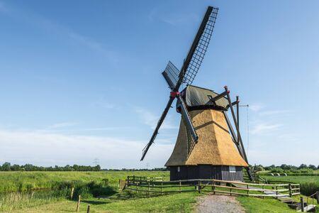Wedelfelder Wasserschoepfmuehle. Old East Frisian windmill on a meadow in rural landscape in Lower Saxony, Germany