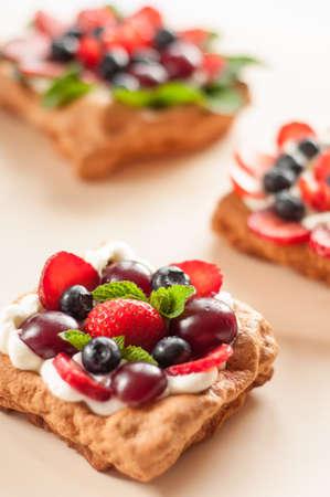 Pavlova dessert with raspberries and blueberries