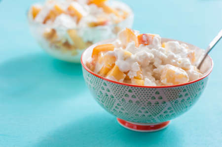 breakfast cottage cheese with peach sour cream and honey Stock Photo