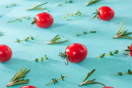 cherry tomatoes pattern with rosemary and thyme